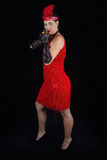 Dangerous beautiful brunette in 1920 style attire red dress feat Royalty Free Stock Image