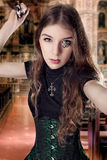 Dangerous beautiful woman Stock Images