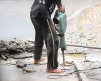 Dangerous behavior for drilling concrete. Stock Photo