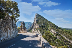 The dangerous bend on a mountain road Stock Image