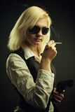 Dangerous blonde with gun Stock Image