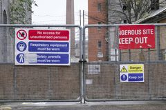 Dangerous building construction site keep out health and safety signs. Uk royalty free stock photography