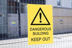 Dangerous building keep out sign construction site fence. Uk health and safety royalty free stock photos