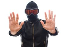 Dangerous burglar in black. Dangerous burglar dressed in black wearing a mask on head - isolated background Royalty Free Stock Images