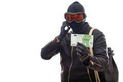 Dangerous burglar in black. Dangerous burglar dressed in black wearing a mask on head -  background Stock Photography