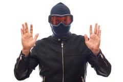 Dangerous burglar in black. Dangerous burglar dressed in black wearing a mask on head - isolated background Stock Image