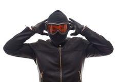 Dangerous burglar in black. Dangerous burglar dressed in black wearing a mask on head - isolated background Royalty Free Stock Image