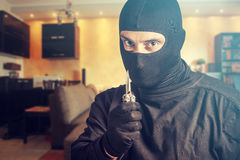 Dangerous burglar holding a knife Royalty Free Stock Photos