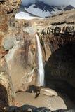 Dangerous Canyon, waterfall under active Mutnovsky Volcano. Kamchatka Stock Image
