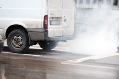Dangerous car pollution. With heavy smoke coming out of an old van Royalty Free Stock Image