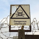 Dangerous chemicals. Warning sign at industrial estate Royalty Free Stock Photo