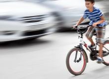 Free Dangerous City Traffic Situation With A Boy On Bicycle Royalty Free Stock Photography - 61318217