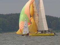 Dangerous convergence of yachts. Photo 6 of 14. The Minsk Sea Zaslavskoe reservoir Republic of Belarus. The first stage of the open Cup `Belarusian Sailing stock photography