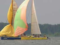 Dangerous convergence of yachts. Photo 5 of 14. The Minsk Sea Zaslavskoe reservoir Republic of Belarus. The first stage of the open Cup `Belarusian Sailing stock photo