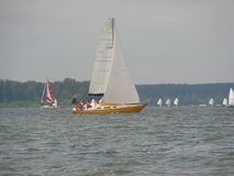 Dangerous convergence of yachts. Photo 12 of 14. The Minsk Sea Zaslavskoe reservoir Republic of Belarus. The first stage of the open Cup `Belarusian Sailing stock images