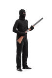 Dangerous criminal holding a shotgun rifle Stock Images