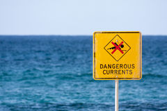 Dangerous currents sign on beach Stock Images