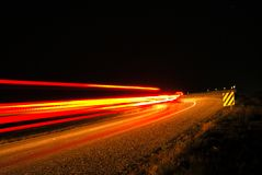 Dangerous Curve. Tail lights are on as traffic approaches dangerous curve stock image