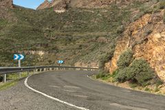 Dangerous curve in Gran Canaria street. In mountains landscape road stock photo