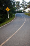 Dangerous curve sign. On the hillside road stock image