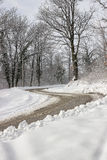 Dangerous double curve on the winter road. Dangerous road at winter stock image