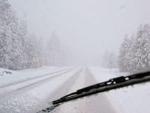 Dangerous driving during blizzard on rural highway