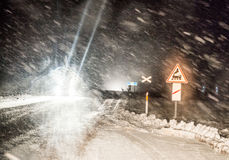 Dangerous driving in winter night. Dangerous driving conditions at night in winter Royalty Free Stock Images