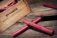 Dangerous dynamite sticks on wooden a box Stock Photography