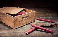 Dangerous dynamite sticks on wooden a box Stock Image