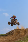 Dangerous extreme sports - jump on the quad Stock Photos