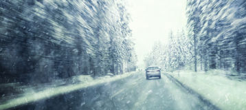 Dangerous fast driving at heavy snowy winter road Stock Image