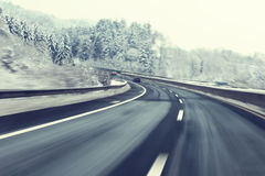 Dangerous fast winter driving Royalty Free Stock Photo