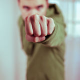 Dangerous fist. Closeup of dangerous man showing fist Royalty Free Stock Photography