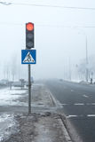Dangerous! Fog on winter highway Royalty Free Stock Photos
