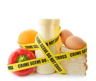 Dangerous food. Food wrapped in crime scene tape stock image