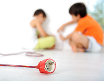 Dangerous game, children experimenting. With electricity Royalty Free Stock Images