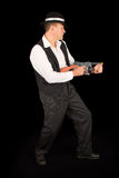 Dangerous gangster with 1920 style clothes standing with gun Stock Image
