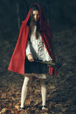 Dangerous gaze from Little red riding hood. With crossbow in the forest Stock Photography