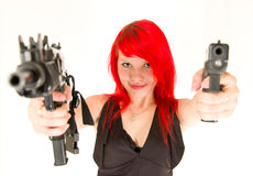 Dangerous girl aiming at you. Dangerous girl pointing guns at you isolated on white stock images