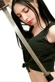 Dangerous girl with sword Stock Photo