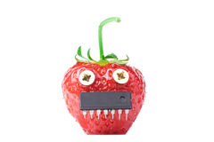 Dangerous GMO. Concept - strawberry with screws and chip. Copyspace added Royalty Free Stock Photos