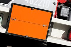 Dangerous goods. Neutral orange-colored plate as identification of the transport of dangerous goods Stock Image