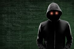 Dangerous hacker over abstract digital background with binary code. Obscured dark face in mask and hood. Data thief. Internet attack, darknet fraud, virtual royalty free stock photos
