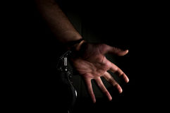 Dangerous Handcuffed Hand royalty free stock photo