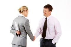 Dangerous handshake Stock Image