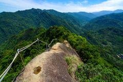 Dangerous hiking trail along a narrow and rocky mountain ridge at Wu Liao Jian in Taiwan Stock Photos