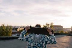 Dangerous hobby. Skateboarder with skateboard stock photo