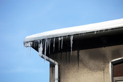 Dangerous icicles on the house Stock Photo