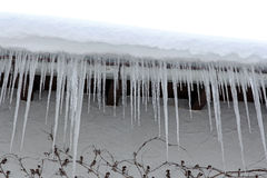 Dangerous icicles Stock Photo