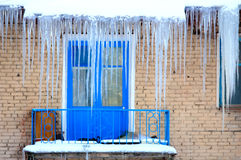 Dangerous Icicles On The Roof Royalty Free Stock Image